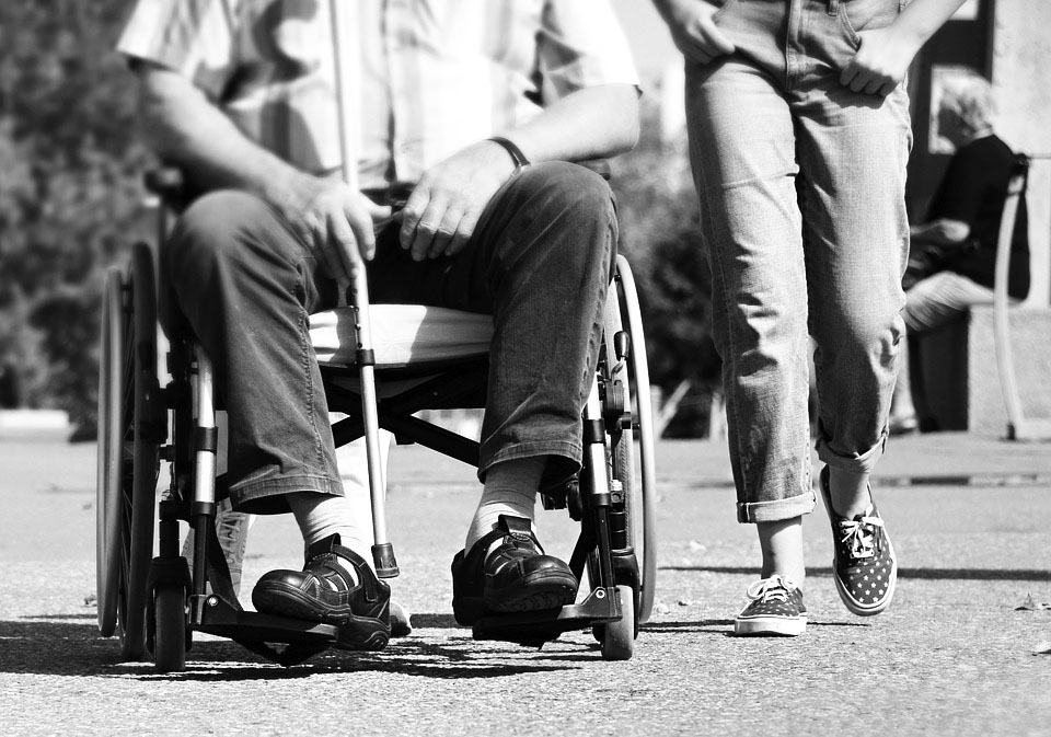 wheelchair-cane user and person walking