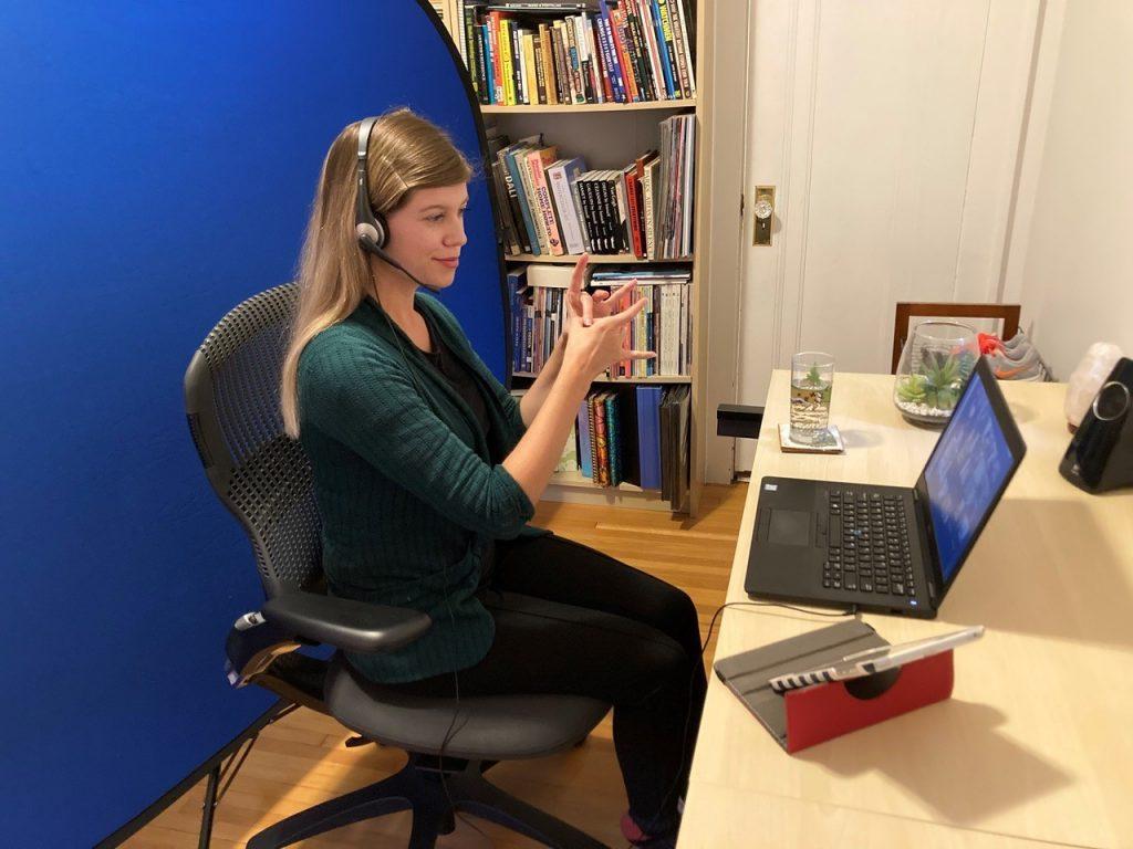 woman signing at laptop