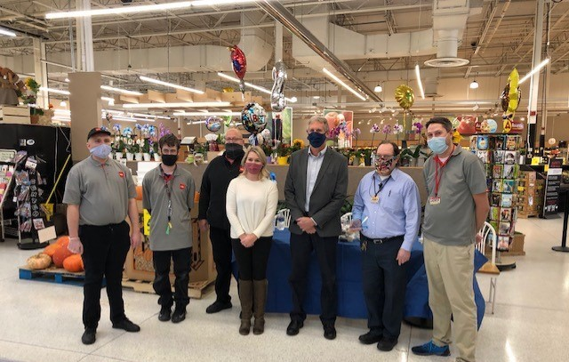 Cub employees pose with masks on