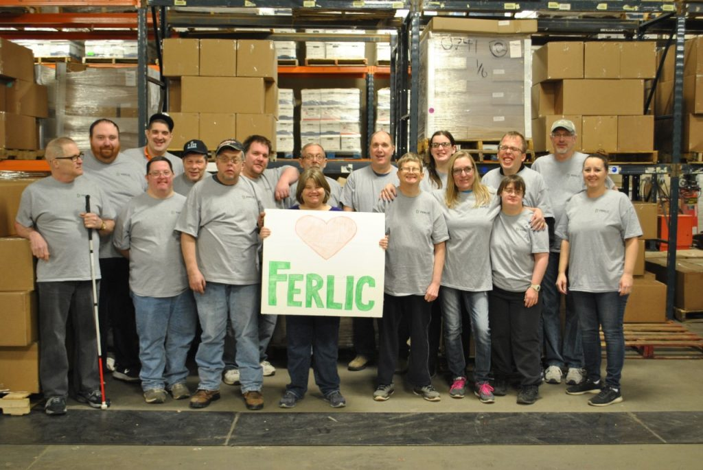 Ferlic employees pose with sign