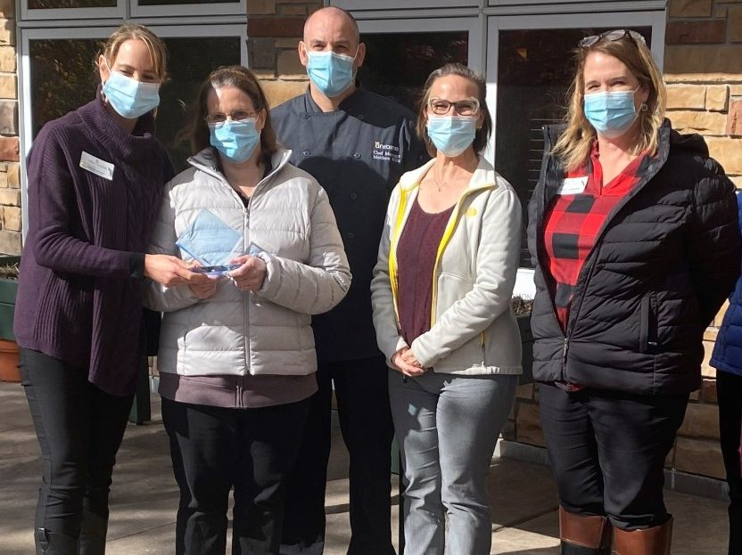 Unidine employees outdoors with masks